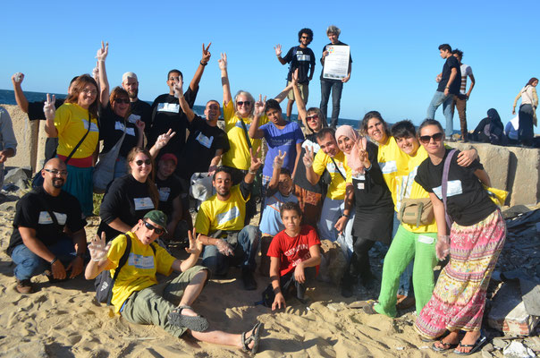 Group photo at the coast of Mediterranean sea, after the clean up