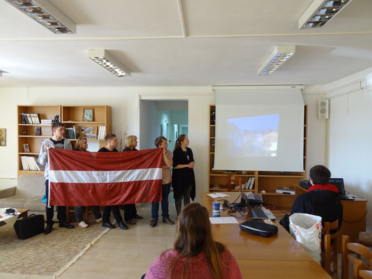 The group of participants from Latvia showing a presentation about the culture in Latvia