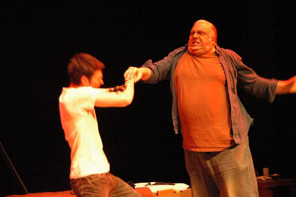 Lennie (John Owens) grabs Curley's hand