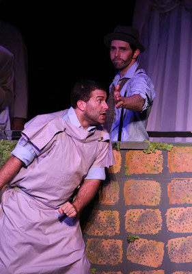 Pyramus (Jon Reimer) peers through the wall's chink