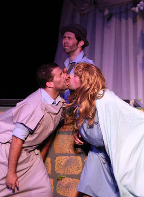 Pyramus (Jon Reimer) and Thisbe (Phil McQueen) kiss through the wall