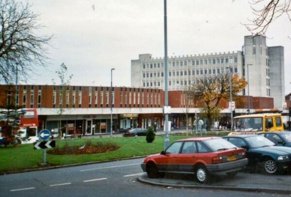 Shop row, 1976, with associated white office block, the Green