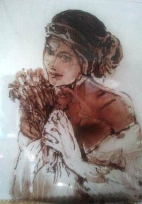 Vrouw met bloemen. Gebrandschilderd glaswerkje  ( tijdens mijn opleiding gemaakt)