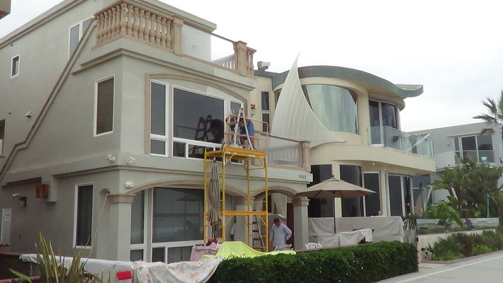 September 2015.  Beachfront Properties at Mission Beach in San Diego painted at the same time in 2007.  Beige House in the back painted with Ceramic InsulCoat Wall.  It is still pristine.  House in the foreground is being re-painted with EnviroCoatings.