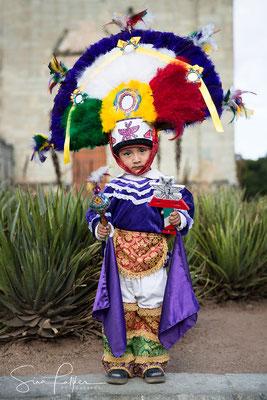 Boy in traditional costume Danza de la Pluma
