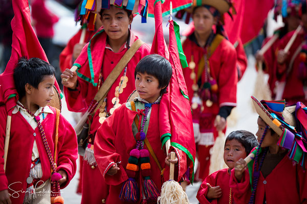 Red robes at carnival in Chiapas