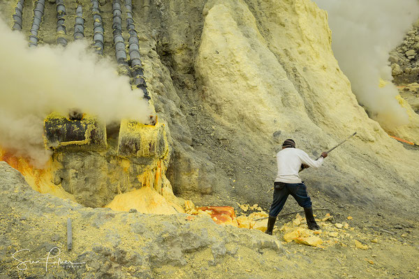 Sulfur mining in the crater of Ijen