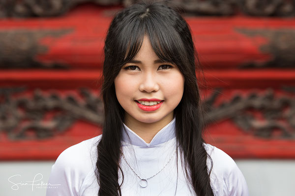 Young girl in the Temple of Literature in Hanoi