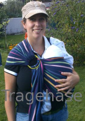 Didymos Lisa Sling mit Neugeborenem