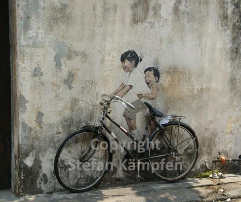 Das Fahrrad als beliebtestes Transportmittel Malaysias ist beliebt bei jung und alt
