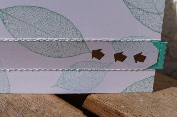 Ein Reißverschluss aus Papier, um die Überraschung freizulegen.