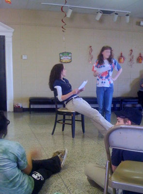 Kids reading scripts from Laurie Allen's books at the Permian Playhouse in Odessa, TX