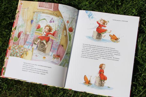 """Das aufgeschlagene Buch """"Erdbeerinchen Erdbeerfee - Sonnenschein und Erdbeerzauber"""""""