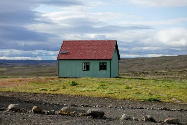 Das grüne Haus im Abendlicht