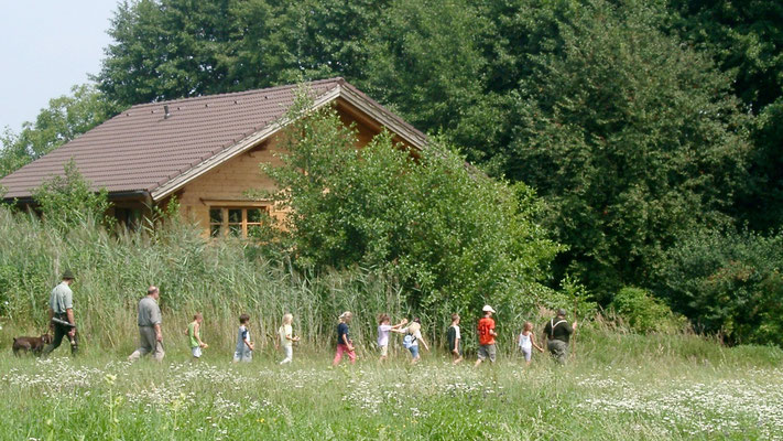 Brandner (neighbour) with schoolchildren on excursion passing the house. Picture 2