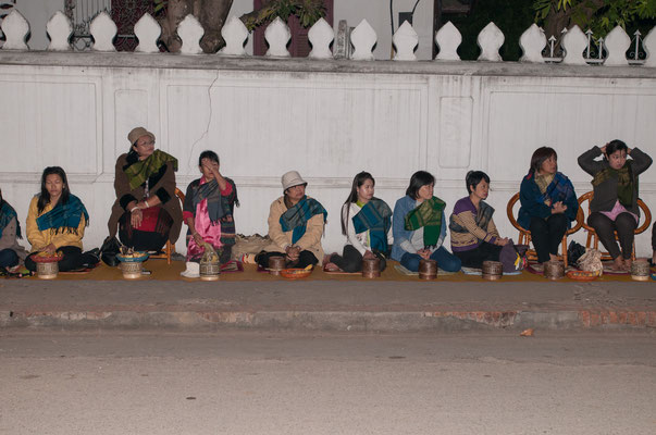 People getting ready to make offerings at the Alms Giving Ceremony in Luang Prabang, Laos