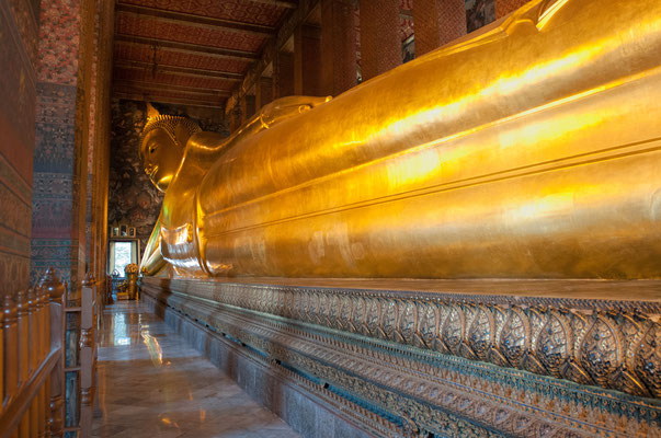 The Reclining Buddha, 151 ft long and 49 ft high, illustrates the passing of the Buddha into nirvana (ie the Buddha's death). The figure is modeled out of plaster around a brick core and finished in gold leaf.