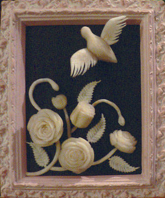 Tableau bouquet en navet et oiseau en radis noir