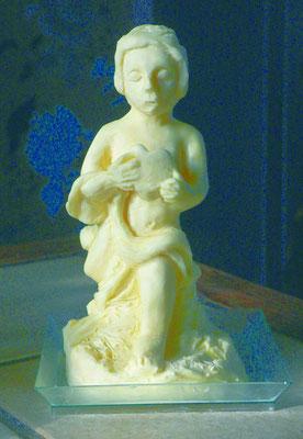 Enfant sculpté en beurre