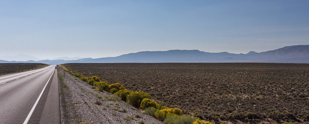 Lonely cycling on the Highway 50. Nevada, USA 8/2014