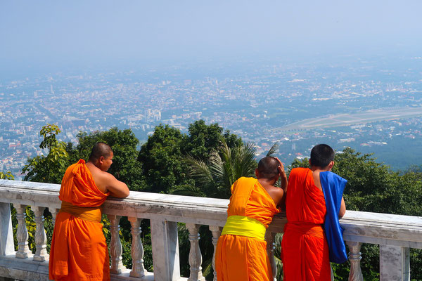 Buddhist monks enjoying the view over Chiang Mai