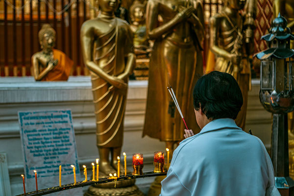 Prayer in a Buddhist Temple
