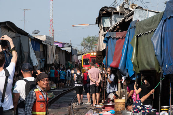 Selling food on the train track? Mai ben Rai - It's going to be ok.
