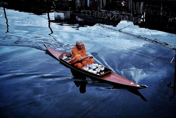 A Buddhist Monk collecting Alms by Boat
