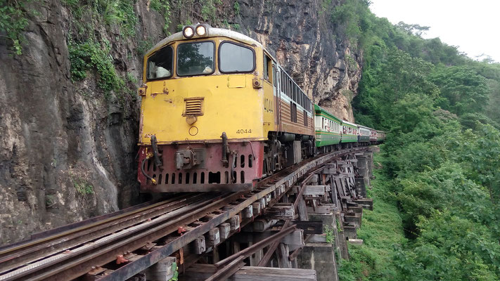 The famous Death Railway arrives at Tham Krasae station