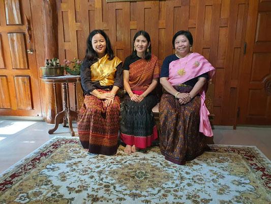 Thai women wearing traditional silk dresses