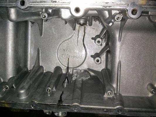 Reparación de cárter de coche mediante soldadura en aluminio.