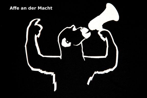 T-Shirt Motiv Affe an der Macht (Affe mit Megaphon).  Klimaneutral, fair und bioologisch produziertes Textil