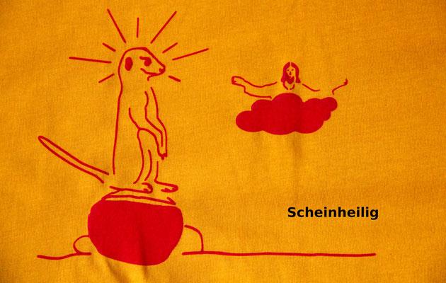 T-Shirt Motiv Scheinheilig (Jesus und Erdmännchen). Klimaneutral, fair und bioologisch produziertes Textil