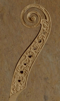 relief carving on the pegbox for a 7 string bass viol - violworks