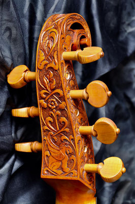 relief carving with animals on a pegbox for a  7-string bass viol, rear view - violworks