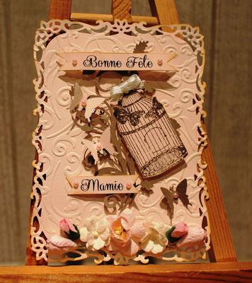 Carte Fête des Grands Mère stons rose avec papillons fleurs et cage à oiseaux