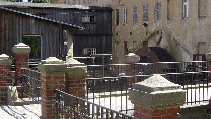 Eine Wassermühle, die um 1858/59 restauriert und wieder in Betrieb genommen wurde.