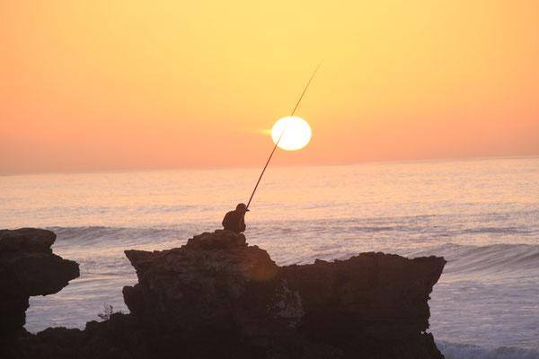 Fischer beim Sonnenuntergang