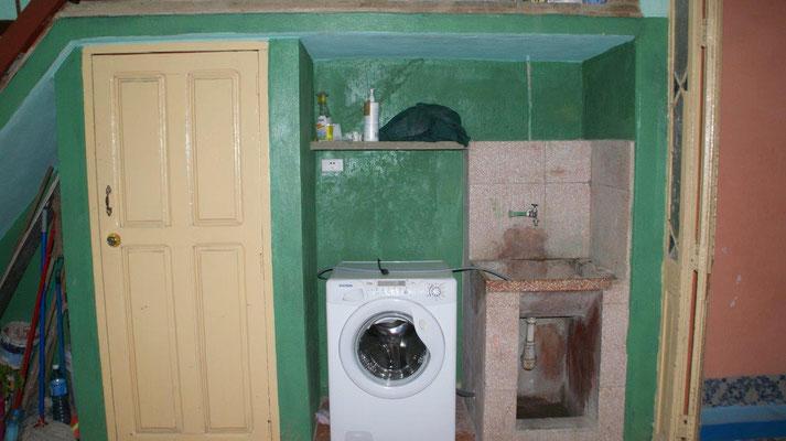 Patio with modern washing machine