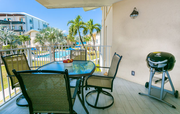 Cayman Reef #57 Patio with rock and swivel dining set