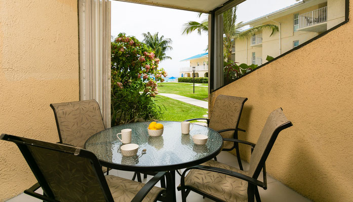 Cayman Reef #17 Patio with comfortable rock and swivel patio set