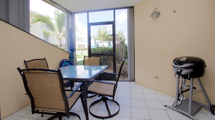 Cayman Reef #36 Patio with rock and swivel patio set