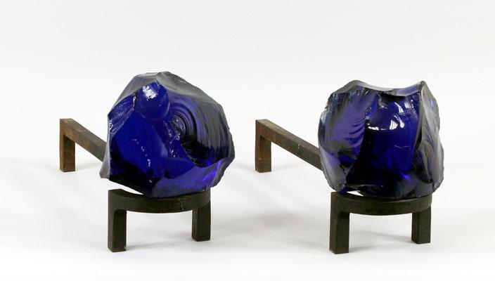 Adjugé 24 770 € - ROYERE Jean, paire de CHENETS en fer forgé et verre bleu, vers 1960