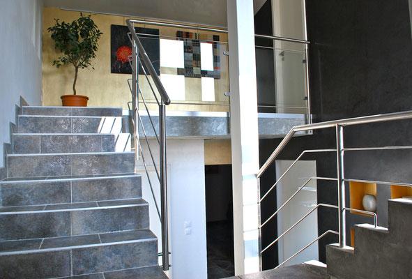 Changement de la rampe d'escalier en verre et inox donnant vers la suite parentale