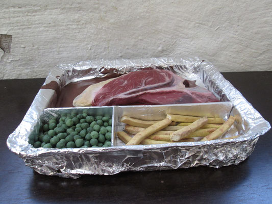 tv dinner . 2014 . lifesize . objects made of unburnt clay and oil paint . in a wrap made of cardboard and foil