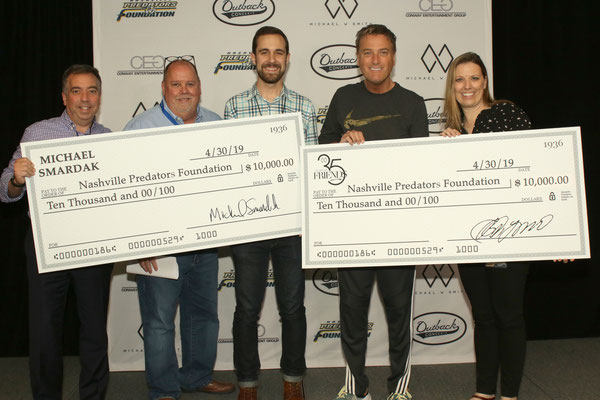 Michael W. Smith & friends present donations to Nashville Predators Foundation  Pictured L-R: Sean Henry, CEO, Nashville Predators; Chaz Corzine, Partner, MWS Group, Manager of Michael W. Smith; Andrew Farwell, Director of Live Entertainment, Outback Pres