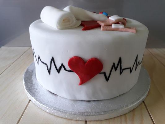 Motivtorte Arzt mit Herzschlag