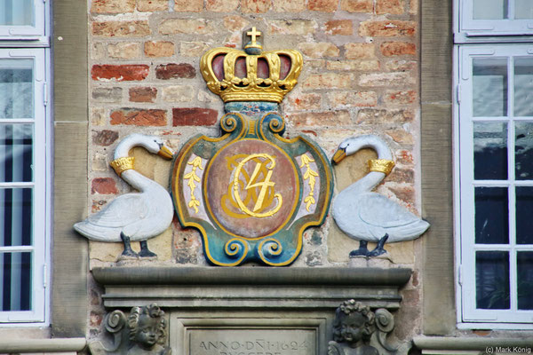 An ornament with swanes which is part of the facade of Jens Bangs Stenhus in Aalborg (Jutland) reveals the year of completion 1624