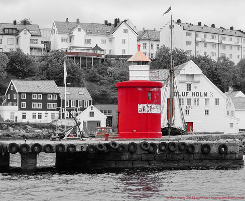 Small lighthouse at Alesund port.