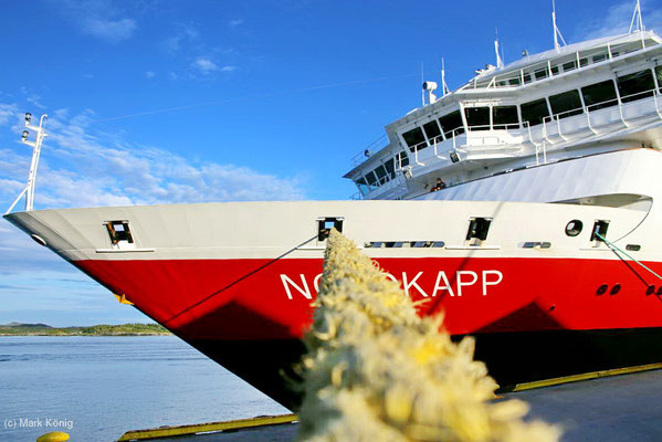 "The bow of the Hurtigruten coastal vessel ""MS Nordkapp"" photographed along a yellow mooring line"